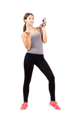 Sporty woman with dumbbells beckoning