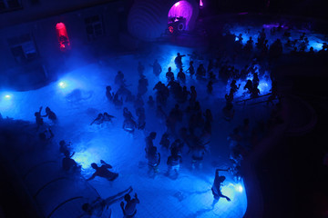 Night party in thermal bath in Budapest, Hungary.