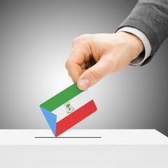 Voting concept - Male inserting flag into ballot box - Equatoria