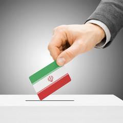 Voting concept - Male inserting flag into ballot box - Iran