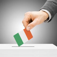 Voting concept - Male inserting flag into ballot box - Ireland