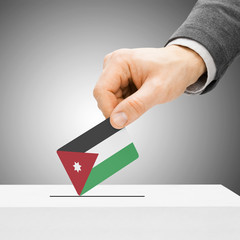 Voting concept - Male inserting flag into ballot box - Jordan