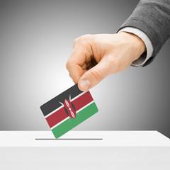 Voting concept - Male inserting flag into ballot box - Kenya