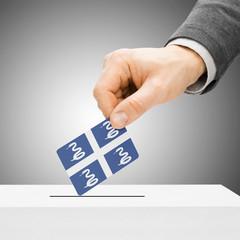 Voting concept - Male inserting flag into ballot box - Martiniqu