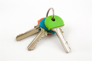 Three House Keys with coloured caps