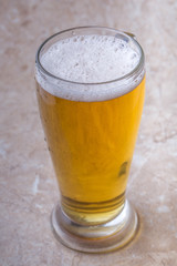top view of glass of beer on stone background