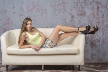 Beautiful girl in summer clothes posing playfully