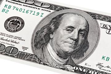 Stack portrait of Benjamin Franklin on one hundred dollars bill.