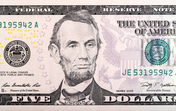 Abraham Lincoln on five dollar bill.