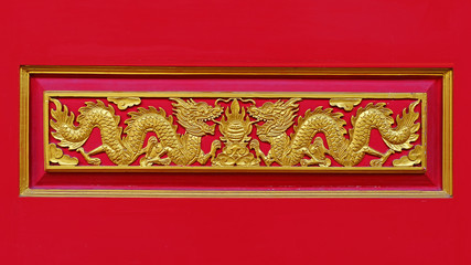 Wood carved golden dragon.