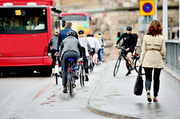 Commuters on their way home on bikes in the rain