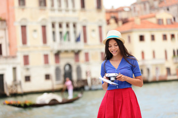 Wall Mural - Italy travel - young woman tourist in Venice canal