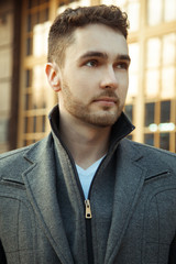 Street fashion.Portrait of handsome man in trendy casual coat.
