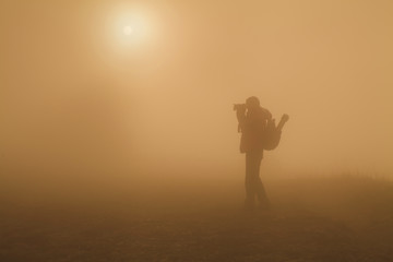 Silhouette of Photographer in the mist