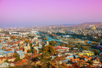 Wall Mural - Beautiful panoramic view of Tbilisi at foggy sunset, Georgia
