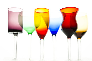 Under view on colorful cocktail glasses