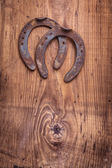 copyspace image two old cast iron metal western horse shoeing ac