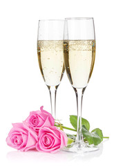 Two champagne glasses and pink rose flowers