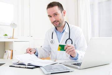 Young attractive doctor taking health insurance card