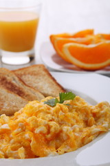 breakfast with scrambled eggs and orange juice