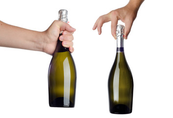 Hand holding bottle of champagne on white