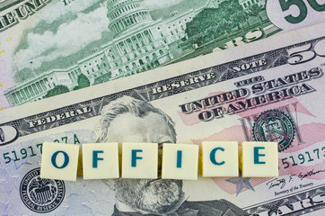 Office word on dollar background. Finance concept