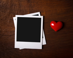 Polaroid frames with red heart