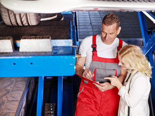 Customer and mechanic looking at a quotation