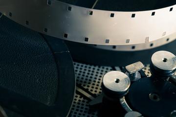 Film reel inside old-fashioned retro movie camera mechanism