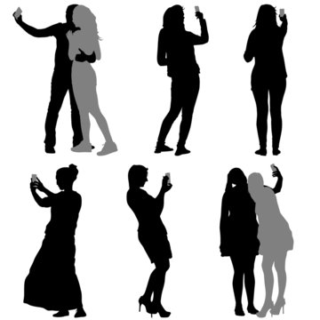 Silhouettes  man and woman taking selfie with smartphone on whit