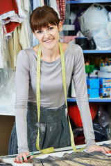 Female tailor portrait at workplace