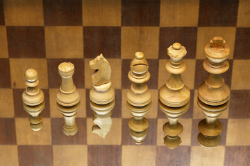 white chess pieces on checkered background