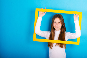 the girl in the yellow frame on a blue background