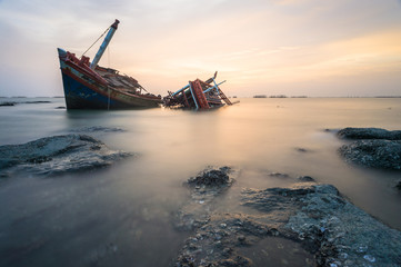 Acrylic Prints Shipwreck Broken ship with the sunset