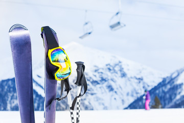 Ski with mask and pole, chairlift on background
