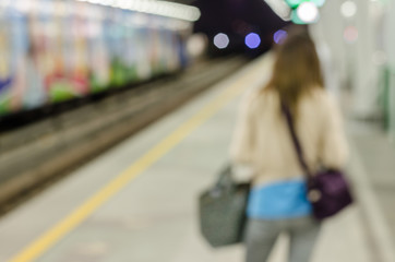 Women waiting abstract blurred electrical sky train station in c