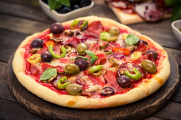 Homemade pizza with ham, cheese and vegetables