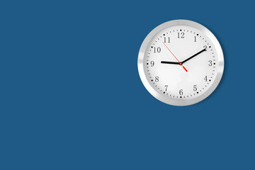 classic clock on blue background with copy-space