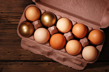 Eggs on a wooden background. Rustic style