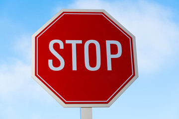 Stop sign in southern California with a sky blue background