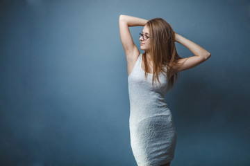 woman  white in dress  glasses in with looking away