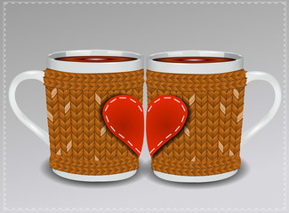Two cups in a sweater decorated with hearts. Valentine's Day.