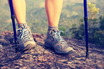 woman hiker  on mountain peak rock
