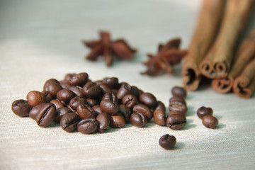 pile of coffee scattered on table with spices