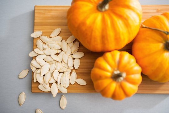 Closeup on small pumpkins and seeds on table