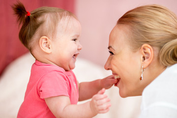 Mom looks with love at baby. Parenthood happiness conception.