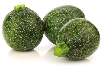 fresh Round Zucchini's on a white background