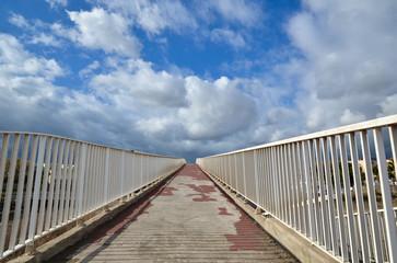 Footbridge with white fence