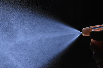 spray from the atomizer spray on black background overlay