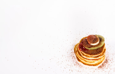 isolated stack of several pancake with cocoa and fruits